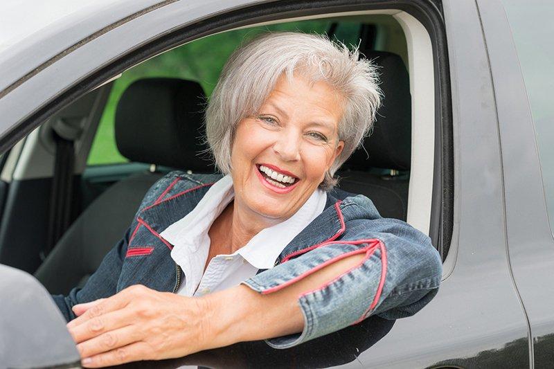 senior driver behind the wheel