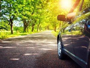 car on summer road