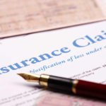 filling out an insurance claim paperwork document