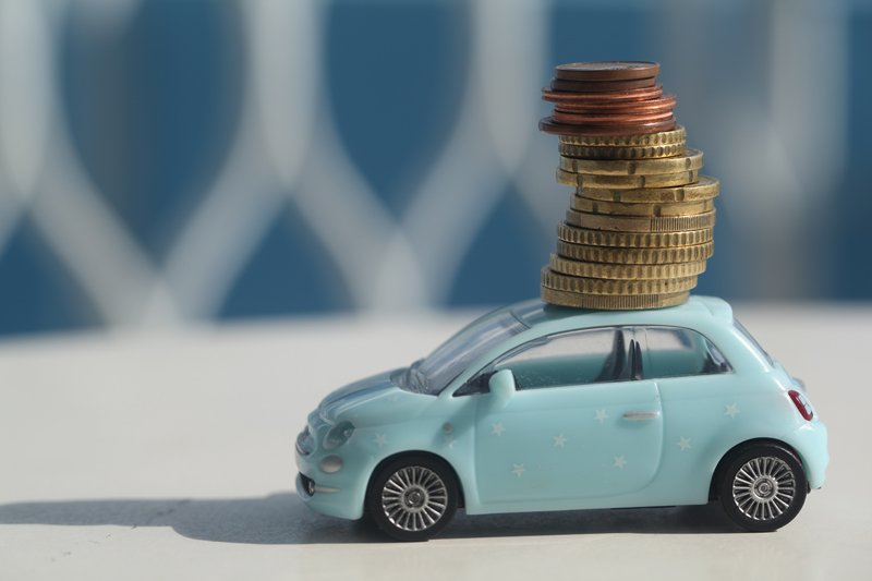 a toy car with coins on top of it